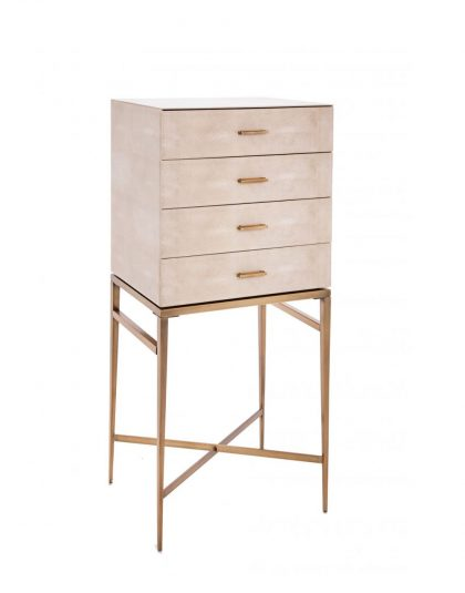 The Esta Cabinet sits high on a set of antique brass legs. It is finished off in a biscuit shagreen glass drawers with antique brass handles.