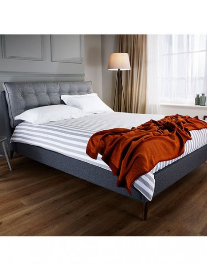 Dexter Den Bed features a distinctive headboard design which incorporates an extremely inviting and comfortable buttoned full width pillow.