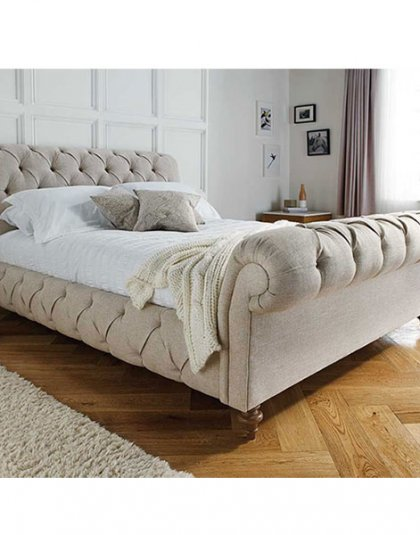 Truffle Den bed features deep buttoning throughout including the side rails. Relaxed diamond pleats.