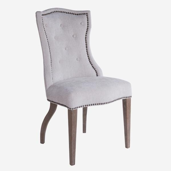 The Janice Chair is Upholstered in an oat-coloured herringbone weave, this chair will have you leaning back into it for hours of dinner conversation,
