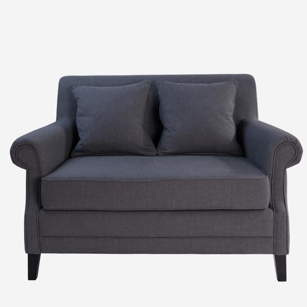 Blanche is a small two-seater sofa with an upright back, slight rollover arms and little wenge legs. Blanche is upholstered in a casual charcoal weave.