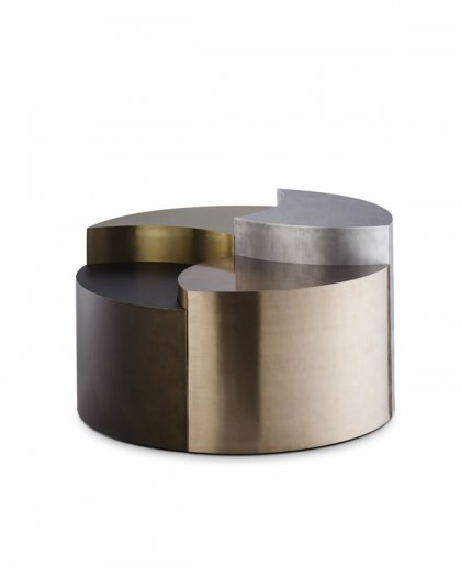 Zebedee Coffee Table by Andrew Martin. Is a circular coffee table with varying levels cut out and finished in different metallic looks.