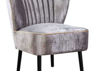 The Peggy chair is a classic mid-century cocktail chair. The chair comes in a shimmering silver velvet with contrast gold piping all around the piece.