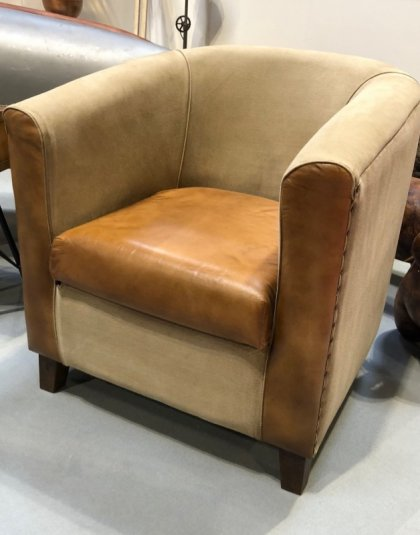 See this Vintage Leather Armchair in your home? The piece comes upholstered in classic leather with subtle silver buttoning.