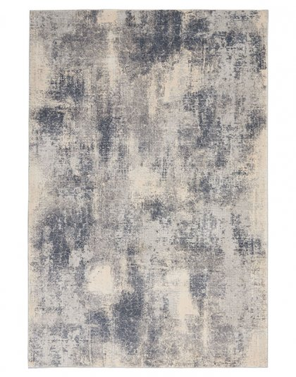 The Rustic Textures Collection from Nourison blends earthen tones and contemporary abstracts together in beautifully textured modern rugs.