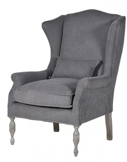 See this beautiful Ashworth Distressed Grey Armchair in your living room?The piece comes upholstered in a grey distressed vinyl with silver studded piping.