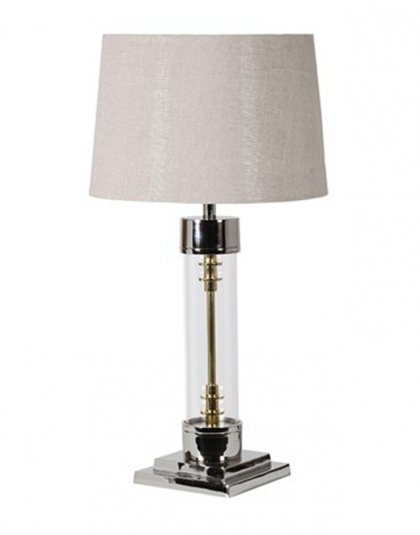 See this Glass Table Lamp with Shade in your homes lighting collection?This piece exudes a sleek yet unique design with its glass base and gold detailing.