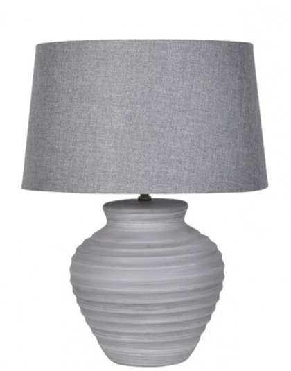 See this Grey Ridged Lamp in your home? This piece perfectly fits those smaller tables whilst brightening up those darker rooms.