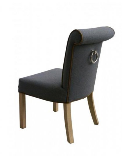 See the Hendon Chair in your Dining Collection? This piece comes upholstered in grey linen with brown piping edges to create a professional design.