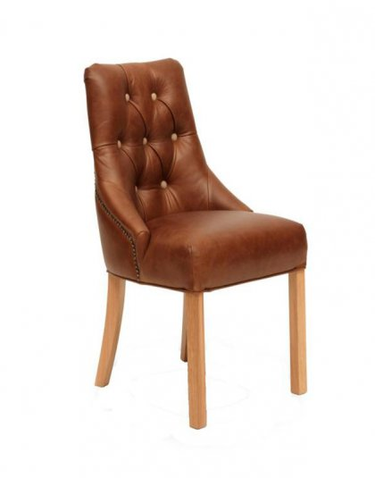 See this Vintage Stanton Chair in your home? The piece comes upholstered in a Brown Classic Leather with sturdy wooden legs.