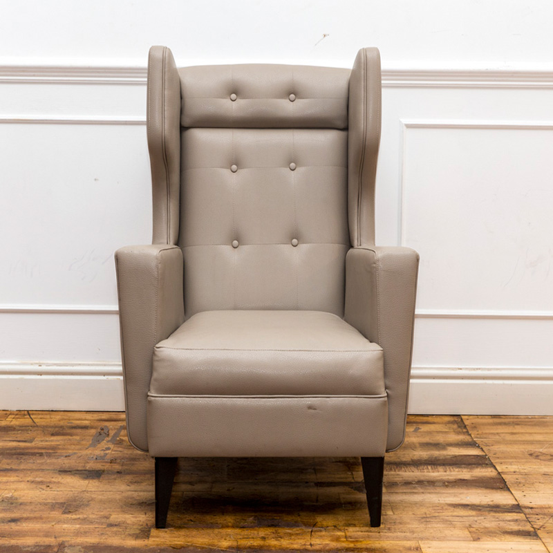 See this Winged Back Armchair in your home?The piece comes upholstered in light grey velvet with a winged back for added design and comfort.