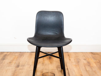 See this Norr 11 Black Leather Dining Chair in your home?This piece comes upholstered in black leather and supported by 4 sturdy acrylic legs.