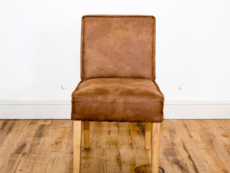 See this Faux Suede Chair in your home? This piece comes upholstered in faux suede fabric.Perfect as an extra seat for those smaller spaces.
