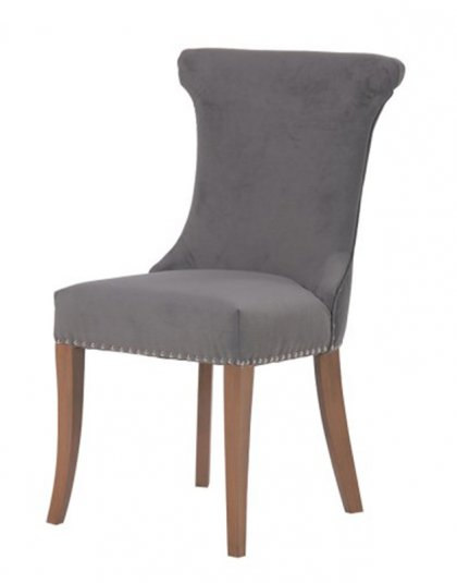 See this French Grey Dining Chair in your dining collection? The piece comes upholstered in a light grey fabric with silver studs for added elegance.