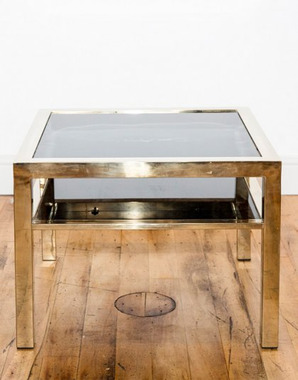 This Glass Top Coffee Table is the perfect addition to any contemporary setting.With its gold finish, this piece exudes a clean design.