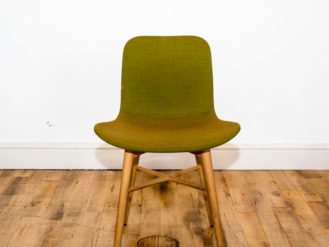 See this Bespoke Upholstered Dining Chair in your seating collection?This piece comes upholstered in green linen with 4 wooden legs for support.