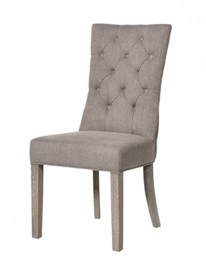 See this Grey Button Dining Chair in your dining collection?This chair comes upholstered in a light grey linen fabric with dense buttoning for added detail.