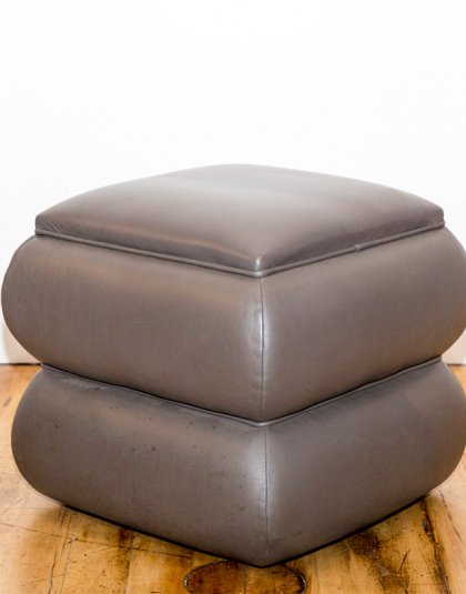 See this Bespoke Footstool in your home?This piece comes upholstered in grey vinyl and exudes a clean yet unique design. Height: 45 CM Width: 50 CM