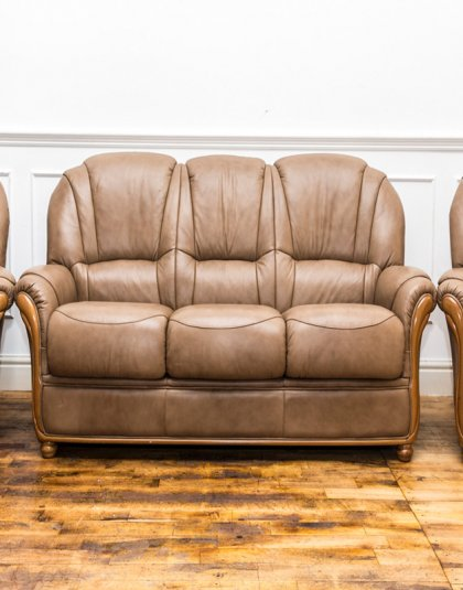 See this Leather Sofa Set in your home? They all come upholstered in classic brown leather with wooden panelling for added design.