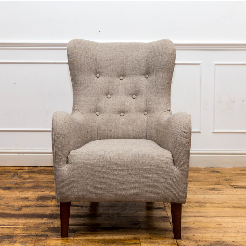 See this Light Grey Linen ArmChair in your home? The piece comes upholstered in a light grey linen fabric and with a dense buttoned back for added design.