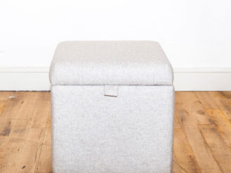 See this Bespoke Linen Footstool Storage Box in your home? The piece comes upholstered in a white linen fabric and has a lift up top for optional storage.