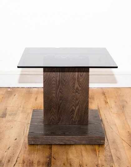 See this Wooden Side Table W/ Glass Top in your home?This piece carries a sleek design which is sure to fit in any interior setting.