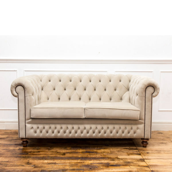See this Cream Buttoned Chesterfield in your home? This piece comes upholstered in Cream House Velvet with deep buttoning for added detail.