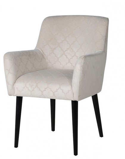 See this Embossed Dining Chair in your home? This piece comes upholstered in a silver embossed fabric which exudes a clean and sleek design